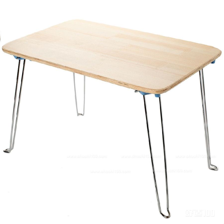 可折叠:这是便携式电脑桌最大的特点了,一般折叠起来只有14寸笔记本大小,非常节省空间,若是出差的话,便携式电脑桌是不必可少的哟! 可调节:桌面翻起的一块可以调节角度,可供上网,看书,画画,写子,看电视轻松自如,两个可折叠小挡板能防止在任意角度上,书和笔记本滑落。固定的面板可以放置鼠标任意滑动,也可放置茶水和笔筒两不误。 专用散热孔:便携式电脑桌拥有专用散热孔,杜绝因长时间运行而死机的现象发生,延长了电脑的使用寿命,为你上网冲浪保驾护航。 笔记本电脑不能接触皮肤的。因为笔记本散热孔就在下面,如果放在皮肤上容