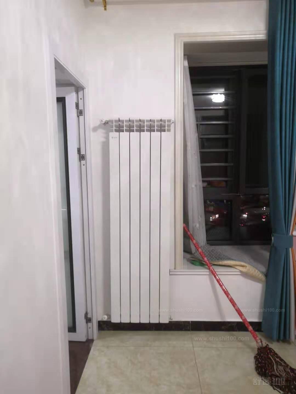主卧室高压铸铝暖气片与客厅遥遥相望